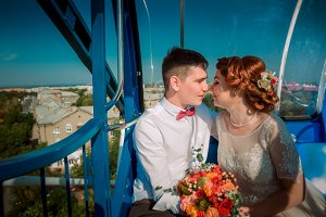 Bride and groom in the Ferris wheel