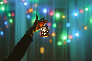 Decoration in hand against lights