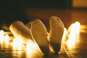 Feet in woollen socks