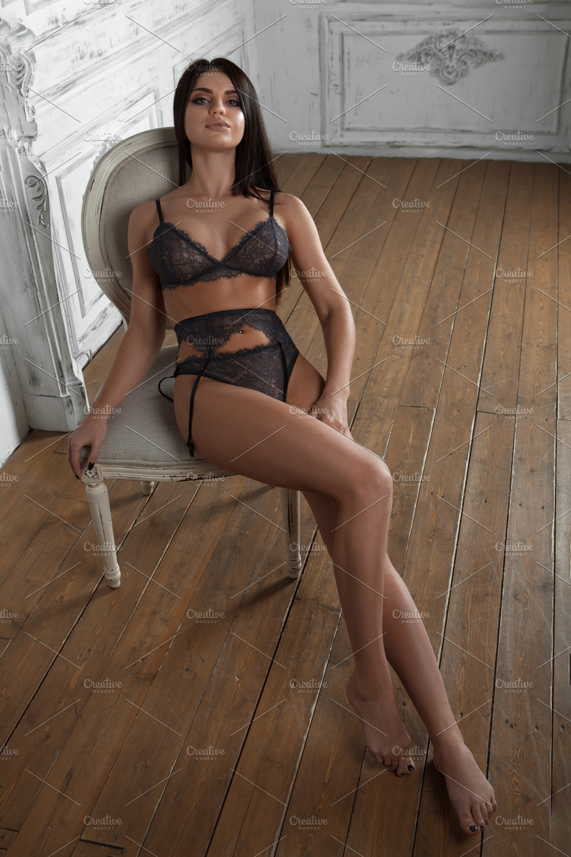70112080269 Very sexy brunette lady posing in black lingerie