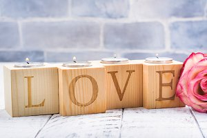 Romantic wooden candle holders with burning tea handles. Valentines day greeting card