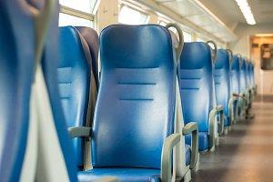 Empty blue seats in train