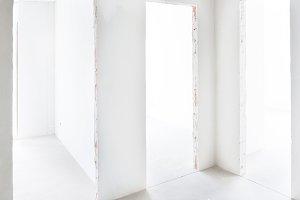 Three doors in white room