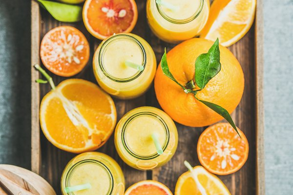 Healthy yellow smoothie in bottles…