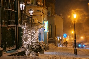 Snowy night scene in a city.