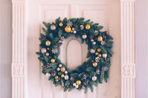 Christmas wreath hangs on the door