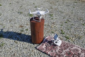 Quadrocopter DJI Phantom 4 on a wooden hemp. Preparing the drone for the flight. Dron is an innovative flying robot.