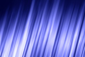 Blue shiny abstract glowing lines background.