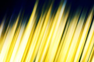 Golden shiny abstract glowing lines background.