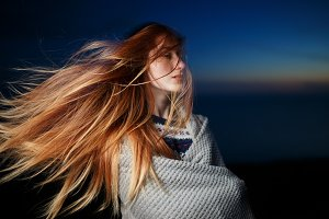 Autumn portrait of beauty redhead girl outdoors in twilight.