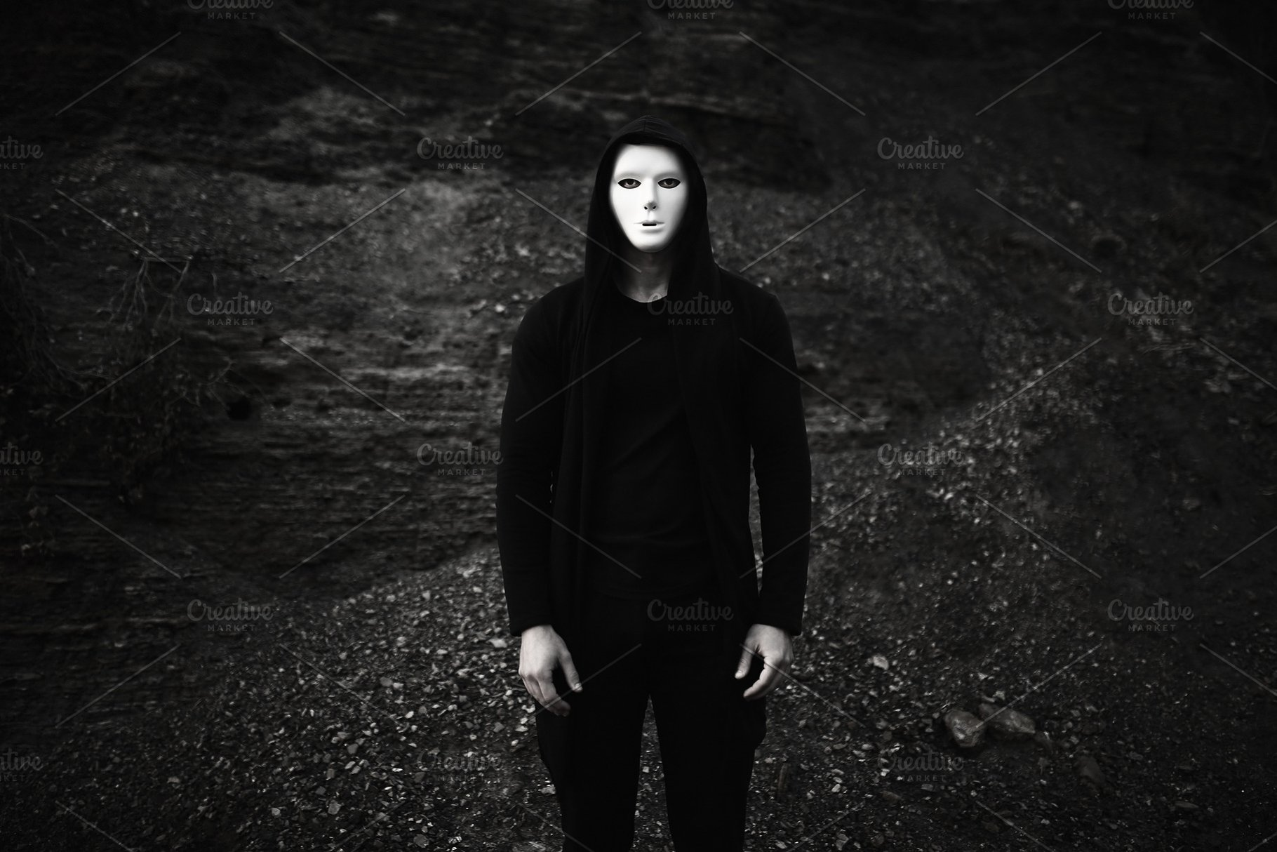 6d282ed8c28 Portrait of man in black hoodie wearing white anonymous mask ...