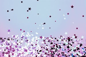 Star shaped confetti on blue and purple background