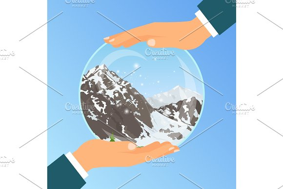 Hand holding glass bowl with mountains in Objects