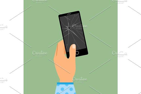 Womans hand holding broken smartphone