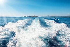 Waves on blue sea behind boat