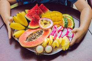 The abundance of fruit on a plate on the table