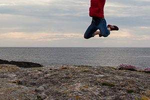 Jumping at Norwegian sea side