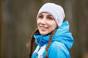 Young happy woman with braids on winter activity