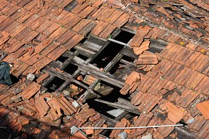 Hole in Old Building Tiled Roof