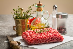 Minced meat with seasoning and fresh thyme