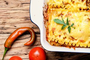 Homemade lasagna on wooden table