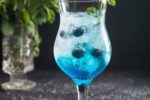 Blueberry cocktail with ice and mint
