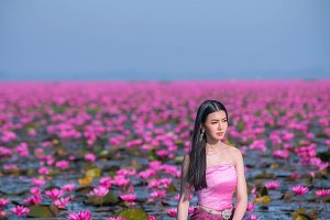 beauty woman on nature red lotus