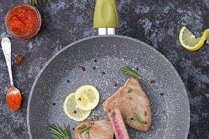Tuna Steaks served on frying pan