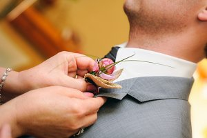 mother putting a flower groom