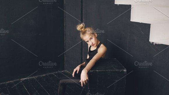 Modern beautiful teenage girl dancer perfomance contemporary dance in ballroom indoors