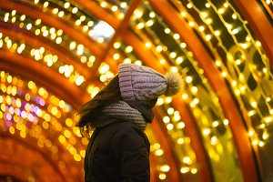 Girl looking up at lights