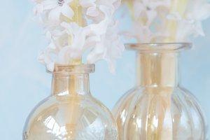 pink flowers in vintage vases