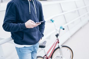 Male BMX rider on street with phone