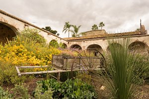 Garden and cart in San Juan Capistrano mission