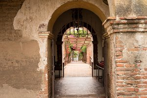 Arches and pathway in San Juan Capistrano mission