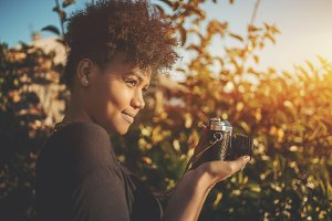 Black girl photographer, retro cam