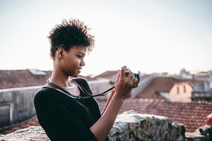 Black girl with vintage photo camera