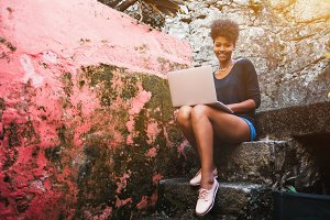 Black undergraduate girl with laptop