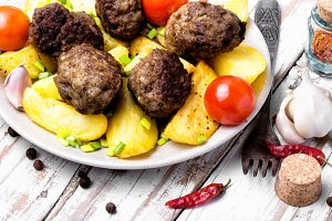 Meat balls with baked potatoes