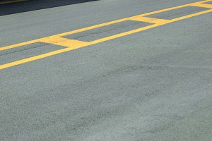 Yellow marking on the road.