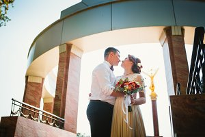 bride and groom on the background of the building