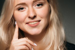 young girl blonde on a dark background
