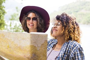 young friends of tour and travel with holiday map