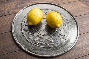 Lemons on metal tray.
