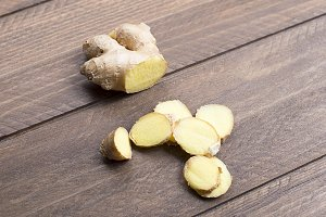 Ginger on wooden table. Food