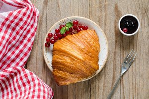 Croissant with fresh berries and jam