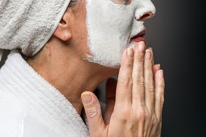 woman is white clay on his face