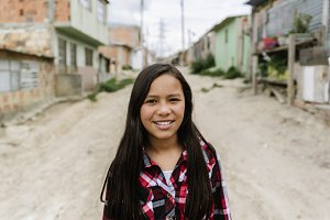 Portrait of cute girl in shanty town