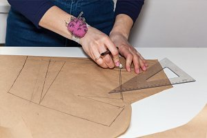 work seamstress making paper patterns