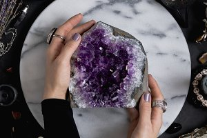 The witch is holding amethyst stone